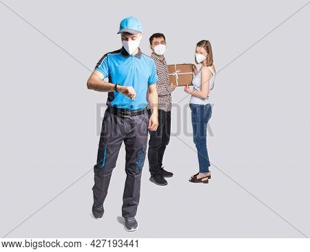Delivery Man Employee In Blue Uniform And Face Mask Delivered The Package And He Is In A Hurry To De