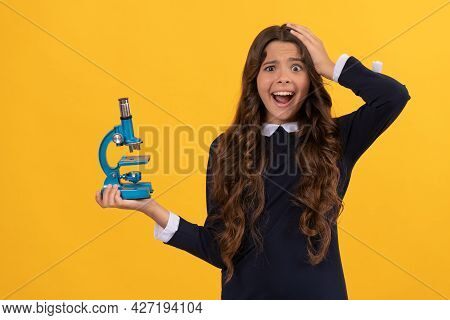 Amazed Kid Hold Microscope For School Education On Yellow Background, Invention