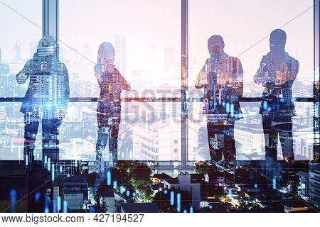 Colleages Standing On Abstract Illuminated City Background With Forex Chart. Teamwork And Finance Co
