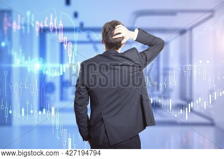 Back View Of Stressed Young Businessperson In Suit Standing In Modern Office Interior With Forex Cha