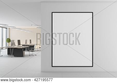 Modern Concrete Coworking Office Interior With Daylight, Empty Frame On Wall, Furniture And Equipmen