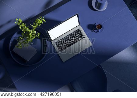 Top View Of Blue Office Workplace With Empty Laptop And Other Items. Hipster Home Workplace. Mock Up