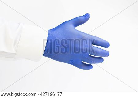 Hand In Blue Latex Glove. Shake Hand. White Background. Copy Space
