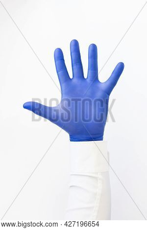 Opened Palm, Hand In Blue Latex Glove .copy Space, White Background