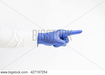 Doctor Wearing Blue Latex Glove And Pointing Index Finger. White Background. Copy Space