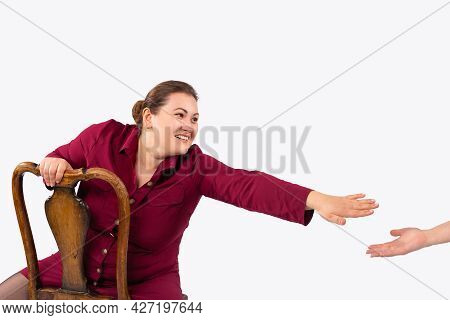 Plus Size Fashion Model In Red Dress, Fat Woman Sitting On A Chair Smiling Reaching Out Her Hand To
