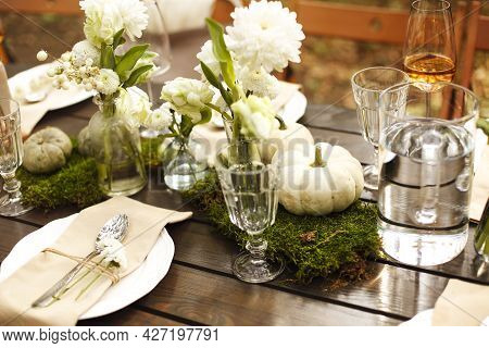 Close Up Photo Of Table Setting In Rustic Style, Romantic Dinner, Cutlery, Flowers And Decorative Sm