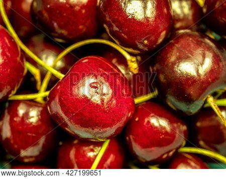 Closeup of pile of ripe sweet cherries shot from above