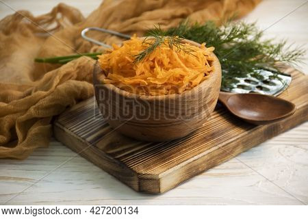 Grated Carrots On Wooden Background Diet, Vegetarian