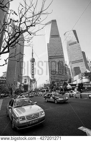 Shanghai, China - April 8, 2014: Taxi car in the street in Shanghai city. Black and white urban photography, wide angle shot