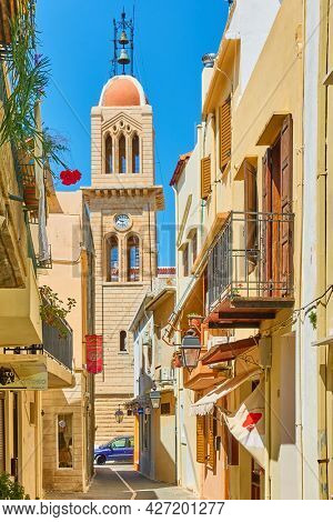 Rethimno, Crete Island, Greece - April 26, 2018: Old street with bell tower in Rethimno town