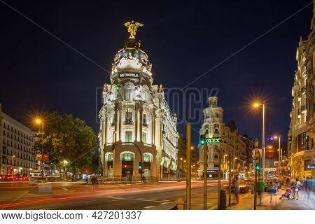 Madrid, Spain - September 04, 2016: Gran Via and Metropolis Building in the City of Madrid at night