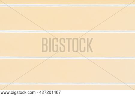 Pastel Yellow Texture Of Plastered Painted Wall With Horizontal Lines, Background