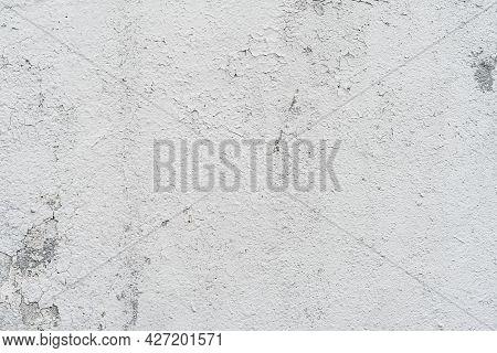 Light Gray Old Wall Close-up, Peeling Plaster. Cracks On Surface. Vintage Background
