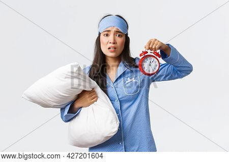 Concerned And Anxious Girl Looking With Panic As Showing Alarm And Holding Pillow, Waking-up Late, O
