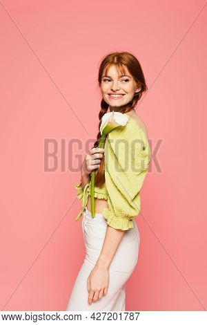 Smiling Freckled Woman Holding Calla Lily Isolated On Pink