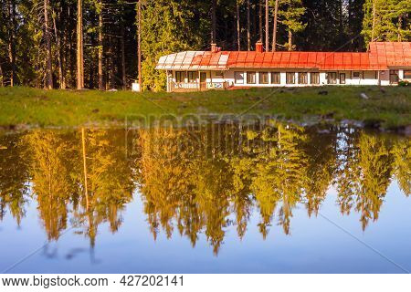 Bansko, Bulgaria Shiligarnika Autumn Ski Resort View With Mountains And House Reflection In Puddle W