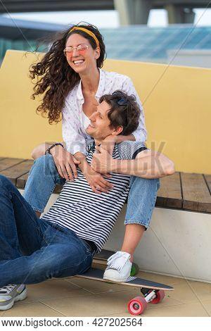 Romantic Couple Having Fun In Modern Urban Skatepark Sit Cuddling In Longboard Happy Talking Laugh E