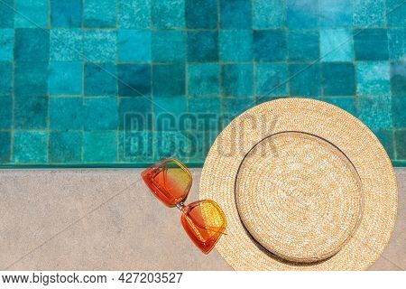 Sunglasses And A Hat By The Pool. Flatlay By The Pool. Summer Concept