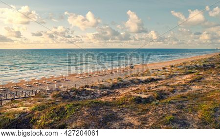 Aerial Drone Point Of View Empty Deck Chairs And Umbrellas On The Sandy Beach And Mediterranean Sea