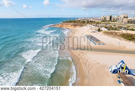 Aerial Drone Point Of View Empty Beach Of Mil Palmeras At Early Morning, Water Attractions On The Sa