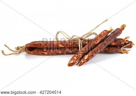 Close-up of smoked sausages with lard isolated on a white background