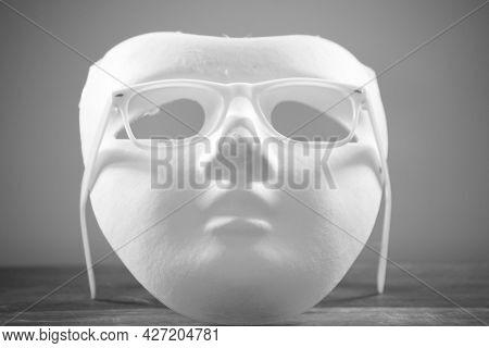 White Mask With White Eyeglass Frames On A White Background