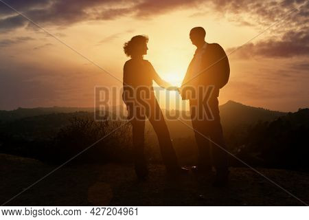 Senior couple in love together at sunset