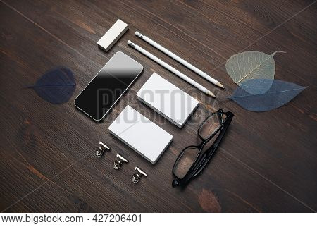 Branding Stationery Template. Blank Business Cards, Smartphone, Pencils, Eraser, Glasses And Leaves