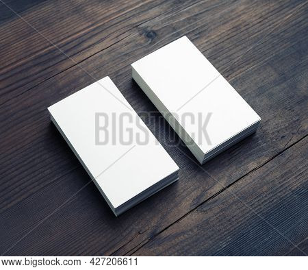 Two Blank Business Cards On Wood Table Background. Branding Mockup.