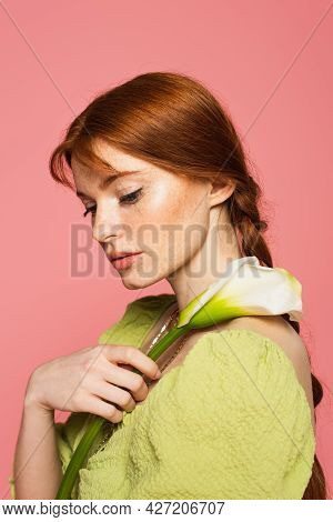 Young Freckled Woman Holding Calla Lily Isolated On Pink