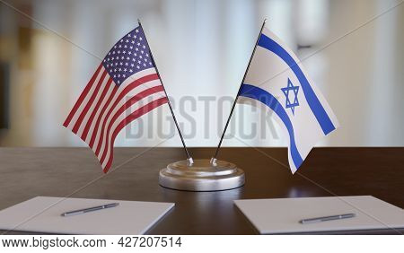 Usa And Israel Flags On Table. Negotiation And Partnership Concept. 3d Rendered Illustration.