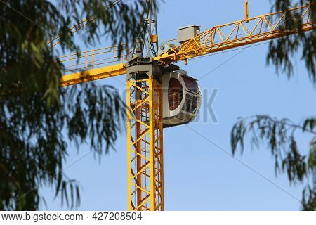 Large Tower Crane Works At A Construction Site In Israel