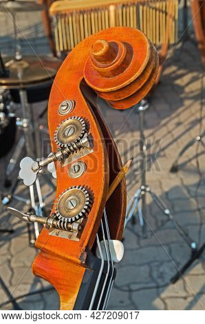 Double Bass Neck. Wooden And Metal Close-up Detail Of An Vintage Stringed Musical Instrument Double