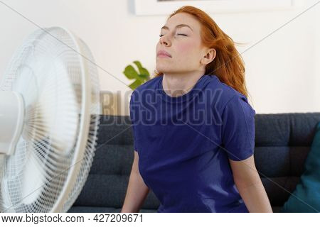 Young Woman Sweating And Feeling Bad For Hot Weather