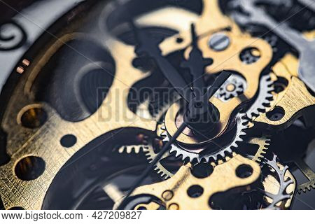 Gears And Cogs Inside Clock. Close-up View On Retro Watches.