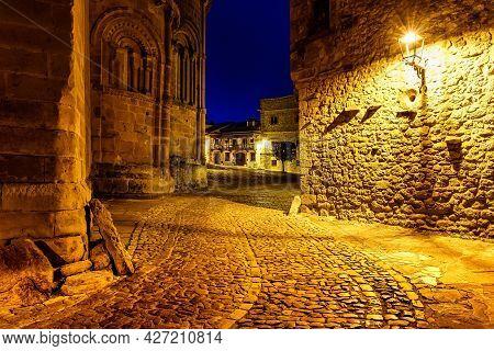 Narrow Alley Lit Up At Night With Street Lamps. Santillana Del Mar, Santander.
