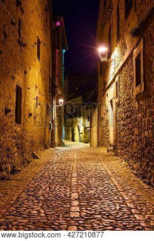 Narrow Alley In Ancient Stone Village At Night. Santillana Del Mar, Santander.