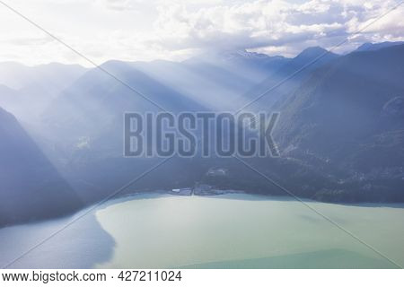Aerial View From Airplane Of A Valley In Canadian Mountain Landscape. Dramatic Sunny Sunset. Howe So