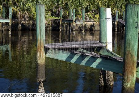 A Series Of Old Broken Abandoned Boat Docks On Overgrown Canal In Bonita Springs Florida.