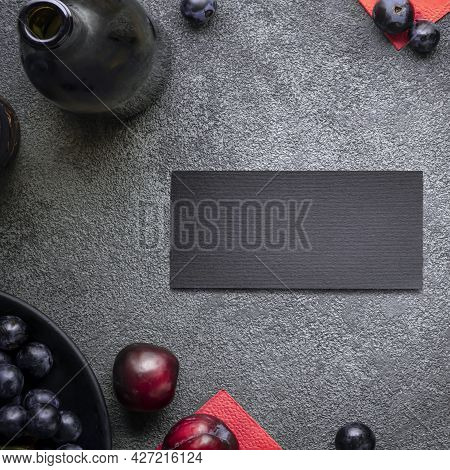 A Postcard Is An Invitation To A Celebration In A Wine Restaurant. Dark Concept With A Bottle Of Red
