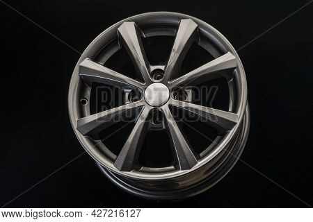 The New Alloy Wheel Is Gray On A Black Background. Auto Parts And Tuning