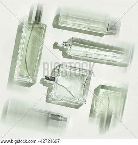 Perfume Bottles Of Green Color. Flatlay Still Life In The Style Of Minimalism On A Lighr Green Backg