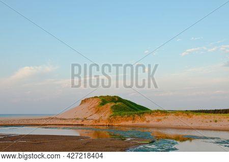 Red Sand Beach At  Prince Edward Island, Canada