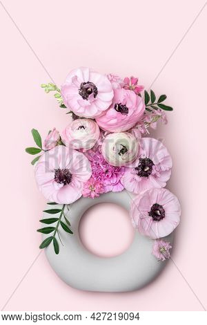 Flat Lay With Tender Ranunculus Flowers In Trendy Ceramic Minimalistic Vase On Pink Background With