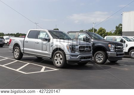 Plainfield - Circa July 2021: Ford F-150 And F-250 On Display At A Dealership. Ford F-series Pickup