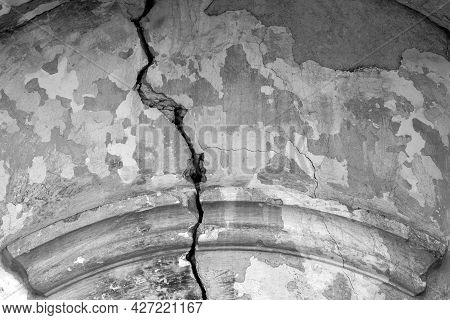 Big Crack On Gray Wall Of Old Building, Abstract Image Of Vertical Crack, Detail. Copy Space. Select
