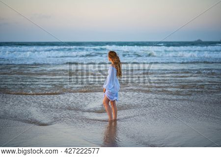 Girl By The Ocean. Concept: Loneliness, Silence, Tranquility