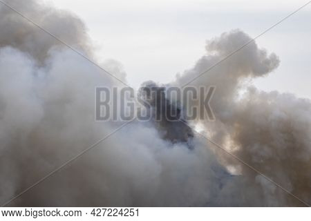 Swirling Smoke From A Large Fire, Similar To Clouds. Cumulus Clouds.