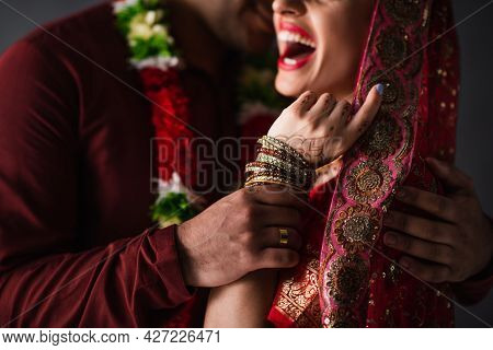 Partial View Of Blurred Indian Man In Turban Holding Hand Of Happy Bride In Traditional Headscarf Is